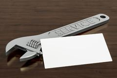Blank business card for handyman`s, repairmans or mechanics on the wooden desk background. 3D rendering. Blank business card for handyman`s, repairmans or vector illustration