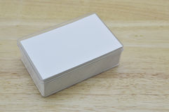 Blank business card inside box on wooden table Stock Photography