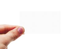 Blank Business Card (isolated). Hand holding a blank white card on a white background Royalty Free Stock Photography