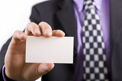 Blank business card in a mans hand. Man holding an empty business card in his hand royalty free stock photography