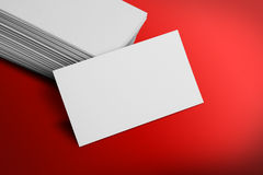 Blank Business Card Mockup on Red Background Stock Photo