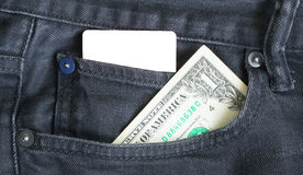 Blank business card and one dollar  in a pocket of gry worn out jeans. Royalty Free Stock Images