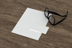 Blank business card, paper and eyeglasses Stock Images