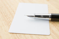 Blank business card and pen Stock Photos
