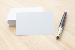 Blank business card and pen Stock Photo
