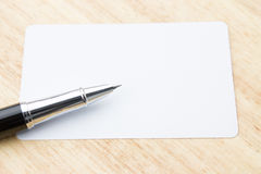 Blank business card and pen Stock Images