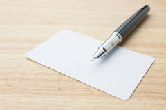 Blank business card and pen Royalty Free Stock Photos