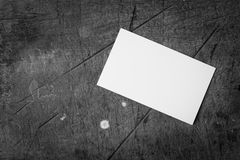 Blank business card is placed on the old wood flooring. Royalty Free Stock Photos