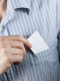 Blank business card in pocket. Businessman taking out blank business card from his pocket stock photos