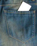 Blank business card  in a pocket of blue worn out jeans. Royalty Free Stock Image