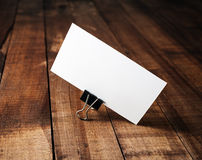 Blank business card. Blank white business card. Blank template for ID. Blank business card on vintage wooden table background. Mock-up for branding identity royalty free stock images