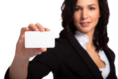 Blank business card in young beautiful brunette businesswoman's hand Royalty Free Stock Photo