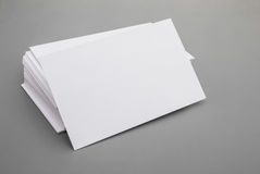 Blank business cards. Stack up on grey background Royalty Free Stock Photography