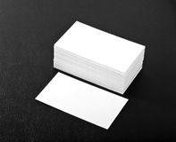 Blank business cards. On a black leather background Royalty Free Stock Photography