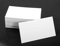 Blank business cards. On a black leather background Royalty Free Stock Photos