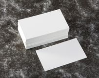 Blank business cards. On a fabric texture background Stock Photography