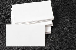 Blank business cards on black leather background Royalty Free Stock Photo