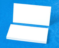 Blank business cards on blue background Royalty Free Stock Photography