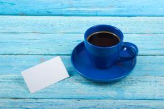 Blank business cards, blue cup on the wooden table. Office desk tabl. Template for ID. Top view. A cup of coffee. Blank business cards, blue cup on the wooden stock photo