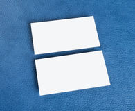 Blank business cards on blue leather background Stock Photos