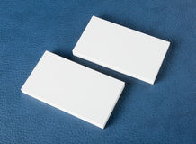 Blank business cards on blue leather background Royalty Free Stock Images