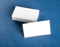 Blank business cards on blue leather background Royalty Free Stock Photography