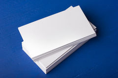 Blank business cards on a blue; wooden background stock photo