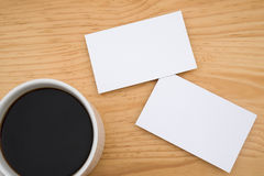 Blank business cards and coffee. On wooden table Stock Photography