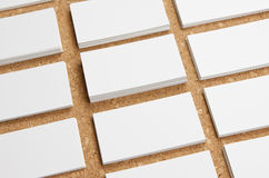 Blank business cards on corkboard background Stock Images