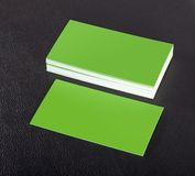 Blank business cards. Green blank business cards on a black leather background Stock Photo