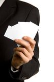 Blank business cards in hand. Blank business cards in the hand of a businessman Royalty Free Stock Image
