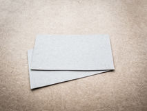 Blank business cards on kraft carboard texture Royalty Free Stock Images