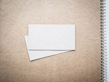 Blank business cards on kraft notebook cover, mockup Royalty Free Stock Photography