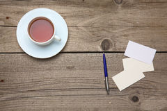 Blank business cards with pen and tea cup on Stock Photography