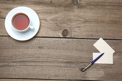 Blank business cards with pen and tea cup on Royalty Free Stock Photos