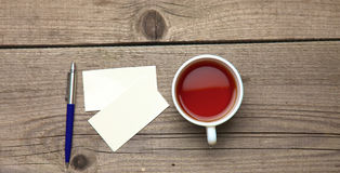 Blank business cards with pen and tea cup on Stock Image