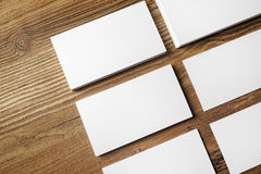 Blank business cards. Photo of blank business cards on wooden table background. Blank paperwork template for placing your design.Top view Royalty Free Stock Image