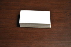 Blank Business Cards. Placed, stacked up on a desk - insert your own design Royalty Free Stock Images