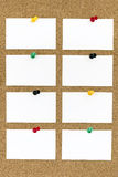 Blank Business Cards with Push Pins on Cork Board. Eight blank business cards with push pins on cork board royalty free stock photography
