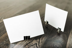 Blank business cards. On wooden background Royalty Free Stock Photo