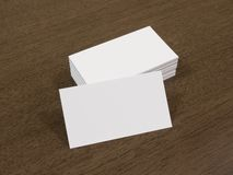 Blank business cards on a wooden background royalty free stock photo