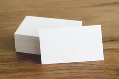 Blank business cards on wooden table. Stock Photos