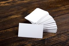 Blank business cards on the wooden table. Template for ID. Top view. Office desk tabl. Blank business cards on the wooden table. Template for ID. Top view stock photography