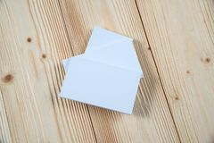 Blank business cards on wooden working table with copy space for add text ID. and logo, business company concept. Idea stock image
