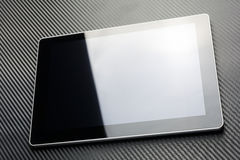 Blank Business Tablet With Reflection Lying On Carbon Background Stock Images