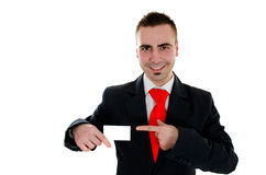 Blank businesscard. Smiling man holding and pointing with finger on blank businesscard Stock Photos