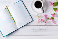 Blank calendar book with Mexican Creeper pink flower. On white wood background royalty free stock photos