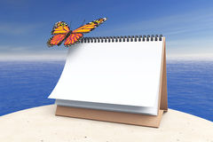Blank Calendar with Butterly in front of Ocean. 3d Rendering. Blank Calendar with Butterly in front of Ocean extreme closeup. 3d Rendering Royalty Free Stock Photography