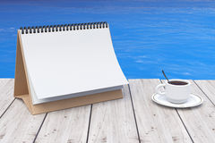 Blank Calendar with Coffee Cup in front of Ocean. 3d Rendering. Blank Calendar with Coffee Cup in front of Ocean extreme closeup. 3d Rendering Royalty Free Stock Image