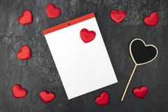 Blank Calendar with little hearts. Little velvet hearts with a blank calendar. Concept romantic stock illustration